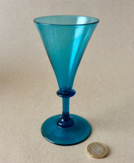 Antique early 19th century plain stem blue wine glass with trumpet bowl.