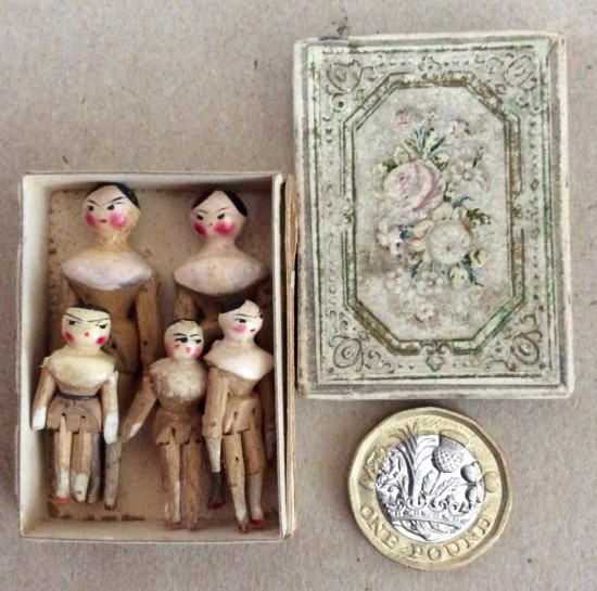 Victorian Grodnertal family miniature wooden peg dolls.