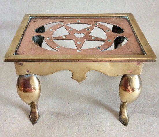 Small late Victorian/Edwardian pierced copper and brass Footman or Trivet.
