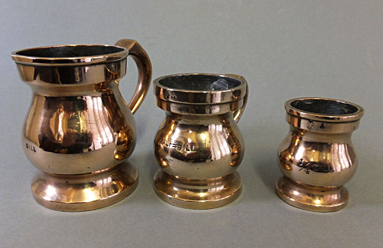 Three brass or bronze gill, 1/2gill, 1/4gill baluster measures.