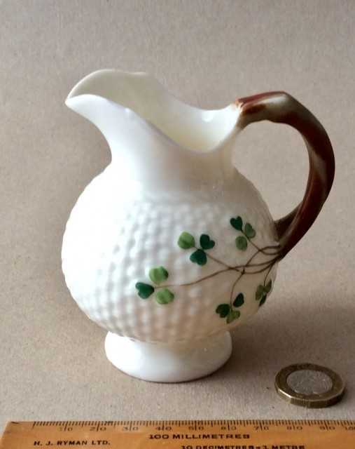 Antique Belleek milk jug with shamrock pattern