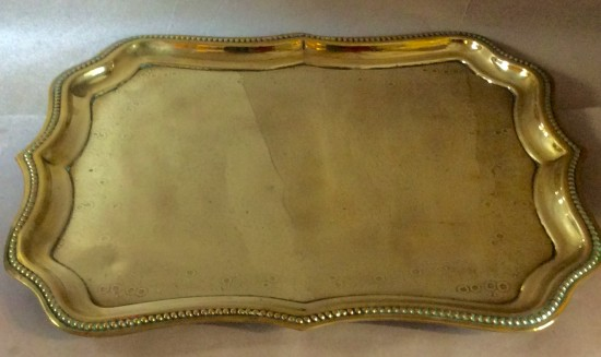Victorian pressed brass tray with wavy edge an flower decoration to centre.