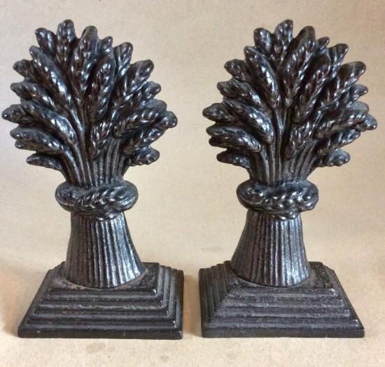 Victorian black painted Cast Iron wheatsheaf door stops or hearth ornaments