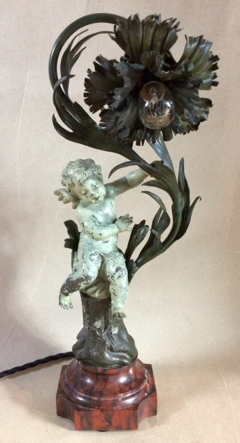Spelter and copper Art Nouveau cherub electric table lamp on good marble socle base.