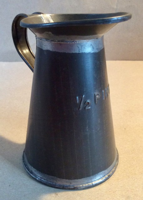 Early 20th century toleware 1/2 pint measuring jug