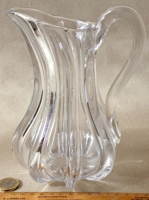 Antique early 19th century clear glass hand blown jug with applied handle.