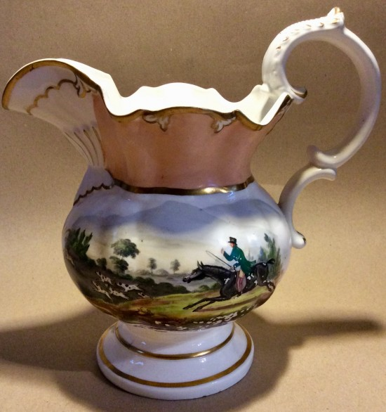 Antique Victorian large jug with hand painted flowers and hunt scene.
