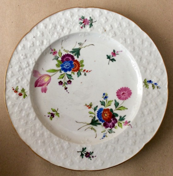 Antique porcelain press moulded German flower plate.