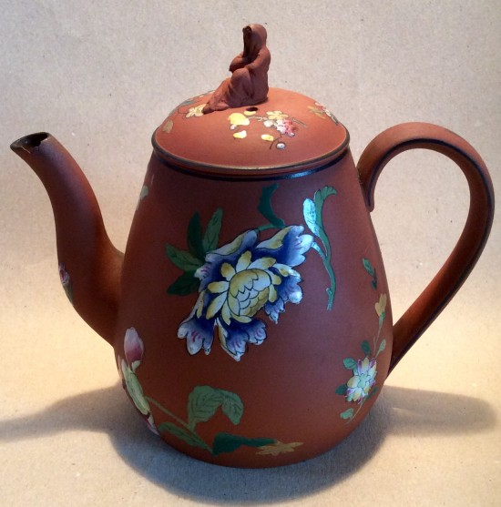 Wedgwood Russo Antico terracotta teapot with enamelled flowers and widow finial