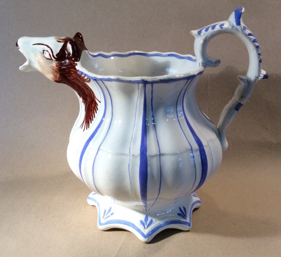 Victorian pottery jug with horse head spout.