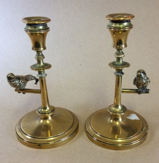 Figural brass candlesticks with swallows on perches