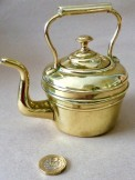 Miniature brass kettle possibly for a child.