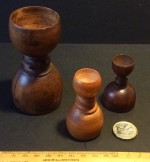 Three antique treen apothecary measures
