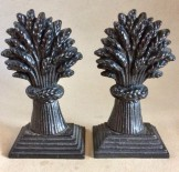 Pair Victorian Cast Iron  wheatsheaf door stops or hearth ornaments