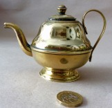 Miniature brass teapot ornament or child's toy.