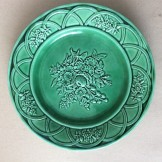 Pair of unmarked majolica  8.75in relief moulded green plates.