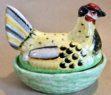 Small pottery Staffordshire Hen on nest egg crock.
