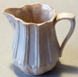 Small drab ware cream jug.