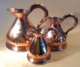 Three copper haystack measures