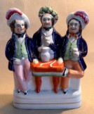 Staffordshire flat back figure of three topers