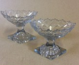 Pair of Georgian cut glass lemon squeezer pedestal salts