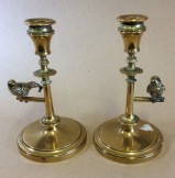 Pair brass figural candlesticks modelled with swallows on perch