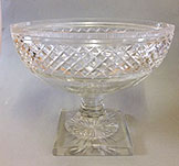 Large cut glass canoe shaped bowl on pedesral stem and square base.