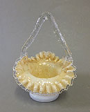 Victorian frilled basket with mica inclusions.