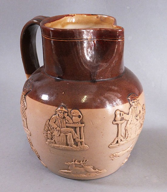 Victorian doulton Lambeth two tone brown jug with sprigged relief decoration.