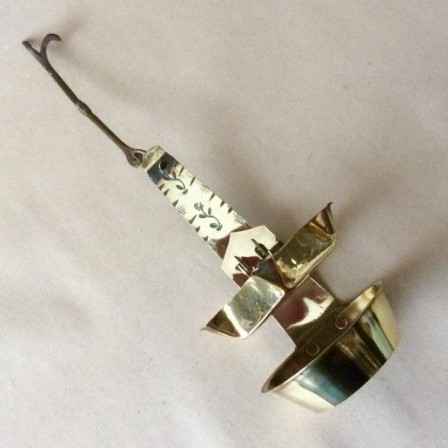 Detail: Antique sheet brass adjustable Crusie oil  lamp with five wick holders.