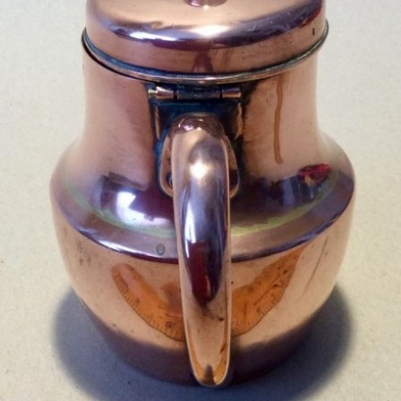 Detail: Antique copper lidded baluster milk?  jug.
