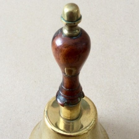 Detail: Antique Victorian brass table bell with turned yew wood handle