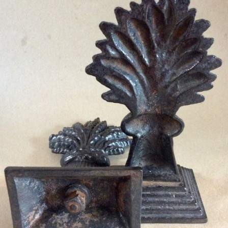 Detail: Victorian black painted Cast Iron wheatsheaf door stops or hearth ornaments