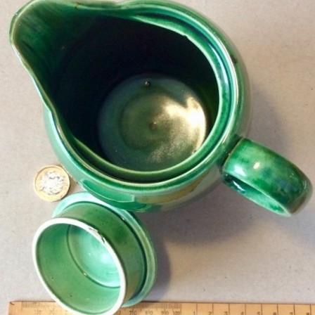 Detail: Antique green glazed ribbed pottery coffee pot