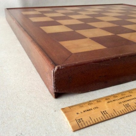 Detail: Antique early 20th century Marquetry chess board. Satinwood, walnut and mahogany.
