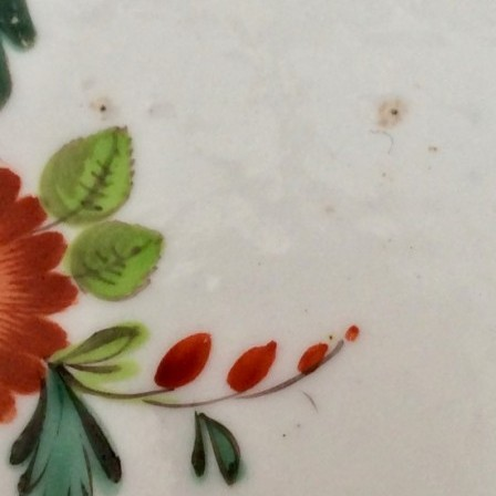 Detail: Antique porcelain press moulded German flower plate.
