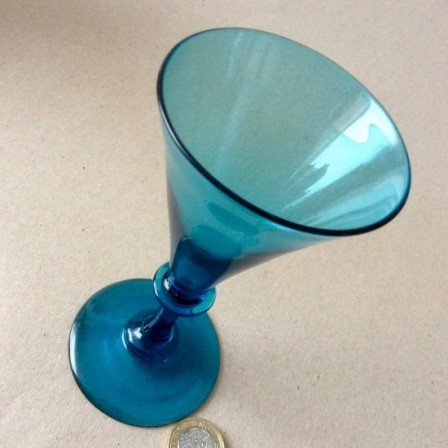 Detail: Antique early 19th century plain stem blue wine glass with trumpet bowl.