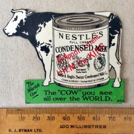 "Detail: Antique Nestle's Advertising card magazine insert. ""The World's Cow""."