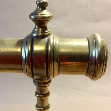 Detail: Antique Victorian brass goffering iron on tripod base.
