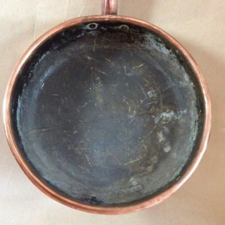 Detail: Victorian copper sauté pan. 30cm diameter.