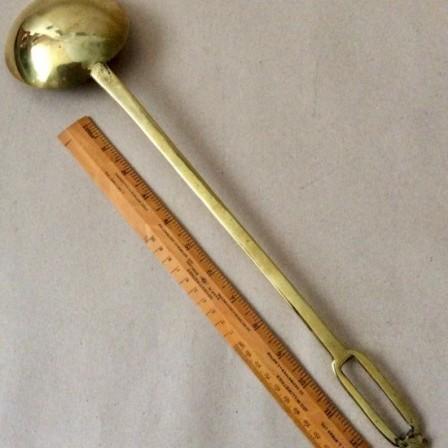 Detail: Antique brass one piece kitchen ladle 45cm long.