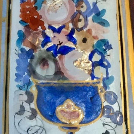 Detail: Antique Tinsel picture of flowers in urn.