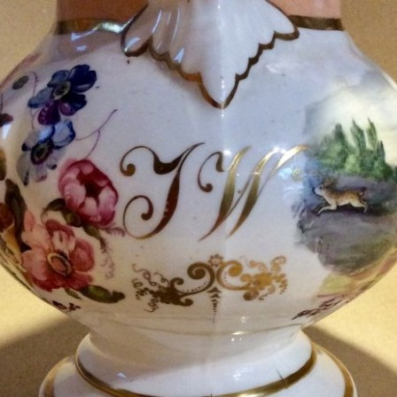 Detail: Antique Victorian large jug with hand painted flowers and hunt scene.
