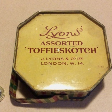 "Detail: Lyons' "" ASSORTED TOFFIESKOTCH"" toffee tin."