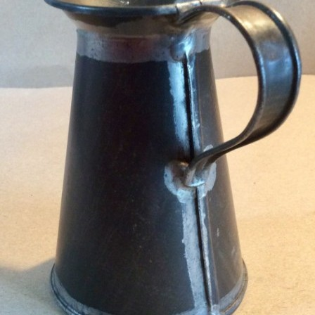 Detail: Early 20th century toleware 1/2 pint measuring jug
