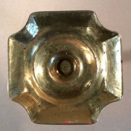 Detail: Seamed C18 single brass candlestick