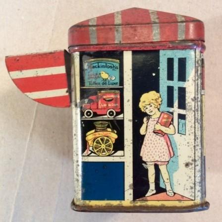 Detail: Rare Mackintosh's figural toffee shop tin c1920
