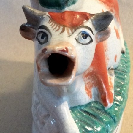 Detail: Victorian pottery Staffordshire cow creamer